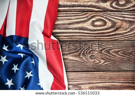 American flag on a wooden table. vignetting for artistic effect