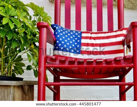 American Flag Pillow In A Red Rocking Chair