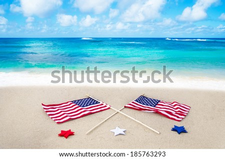 American flags with stars on the beach