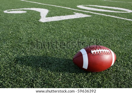American Football along the Twenty Yard Line of the field
