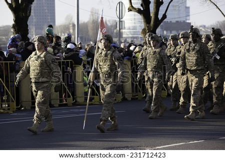 "American Texas soldiers ""Ironhorse""  from forces of NATO at military parade in Riga, Latvia. Parade in honor of proclamation of Latvia at november 18, 2014. People whatching around."