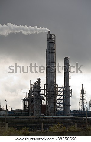 Ammonia still with tubes and smoke. Environment pollution concept