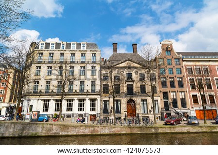 Amsterdam, Netherlands - April 2, 2016: Traditional old buildings, canal view in Amsterdam, Netherlands