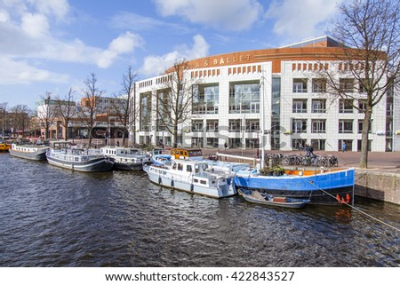 AMSTERDAM, NETHERLANDS on MARCH 27, 2016. Typical urban view. Houseboats near the bank