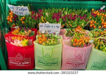 Amsterdam Schiphol, Netherlands - April 18, 2015: Selling colorful Dutch tulips in the bags, the Netherlands