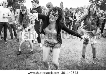 Amsterdam, The Netherlands - July, 5 2015: audience dancing during the concert of Tunisian band Bargou 08 at Amsterdam Roots Open Air, cultural festival held in Park Frankendael on 05/07/2015