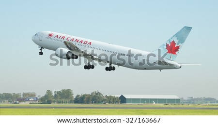 AMSTERDAM, THE NETHERLANDS - OCTOBER 11, 2015: Air Canada Boeing 767-375 (ER) takes off from Schiphol Airport