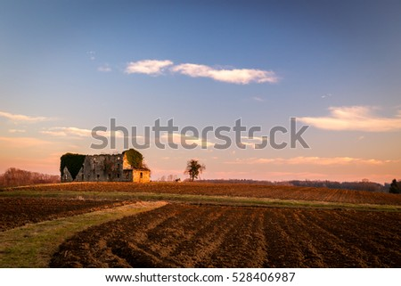 an abandoned and ruined farm in the fields of Italy