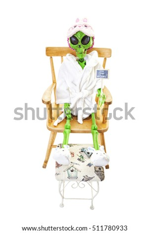 "An alien dressed in a robe, bunny slippers and eye mask, holding a sign that says: ""You saw nothing!"".  Shot on white background."