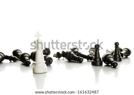 An army of black and white chess pieces. Isolate