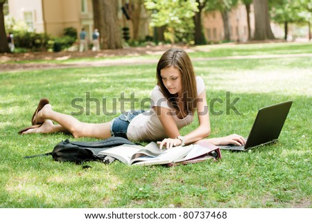 an attractive young student doing homework