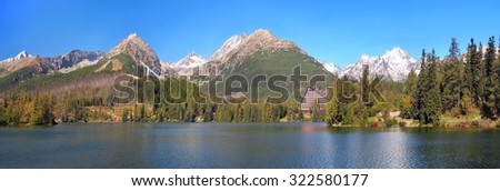An autumn panorama of High Tatras peaks above the Strbske Pleso (tarn). The Strbske Pleso is second largest glacial lake on the Slovak side of High Tatras. It is located in Tatras National Park.