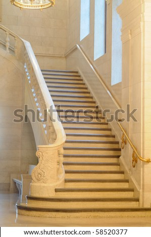 An elegant marble staircase in a venerable public building stock