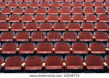 an Empty chairs in a concert hall