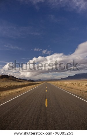 An empty desert highway on a stormy spring day