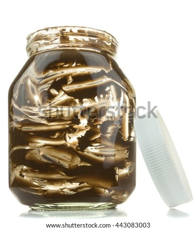 An empty glass jar of chocolate spread on a white background