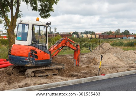 An excavator in a road construction site