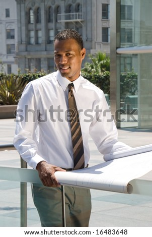 An executive engineer conducting architectural work in a business complex.