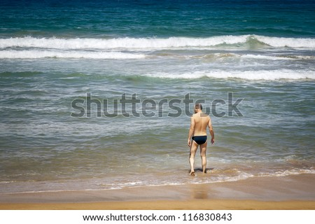An image of a handsome man at the beach