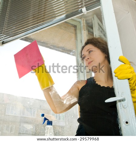 An image of a nice woman cleaning the window