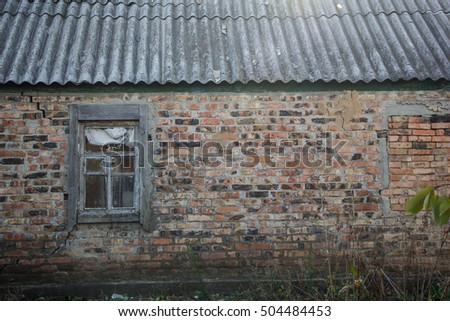 an image of old window on red brick wall