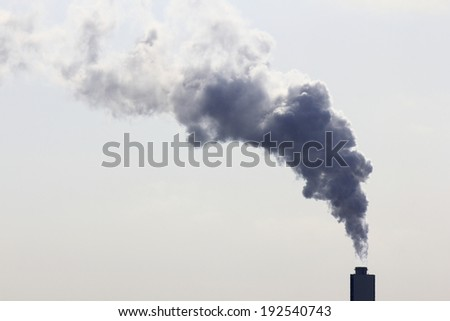 An image of Water vapor containing gas coming out of the chimney