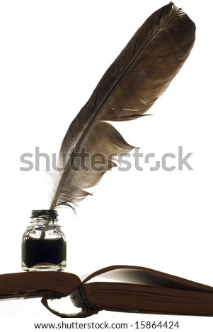 an ink bottle and a quill on the book