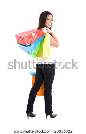 An isolated shot of a beautiful asian girl carrying shopping bags