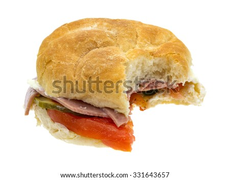 An Italian salami sub sandwich that has been bitten isolated on a white background.