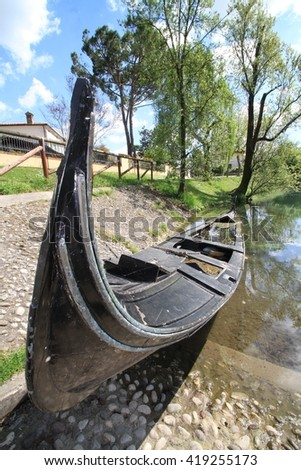 an old abandoned gondola on a river