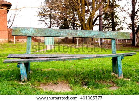 an old bench in the village Park