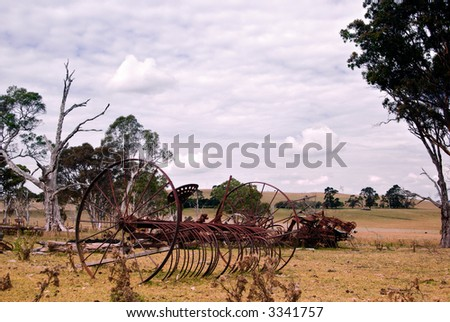 an old plow left to rot in the paddock on the farm