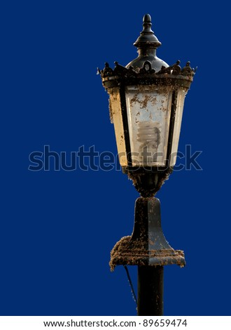 An old street lamp isolated on a blue background.