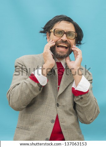 An untidy man, wearing glasses, expressing horror, over light blue background