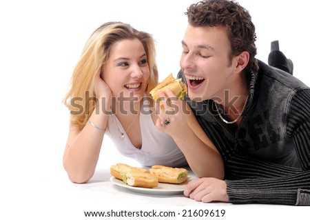 An young attractive couple eating