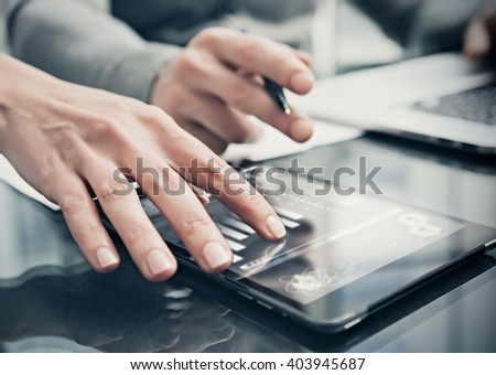 Analytical department working process.Closeup photo woman showing business reports modern tablet screen.Statistics graphics screen.Banker holding pen for signs documents,discussion startup.Film effect