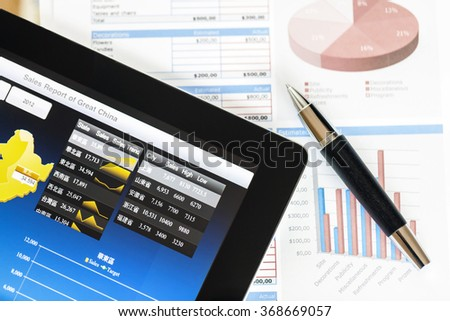 Analyzing Chinese business market from digital tablet with a detailed diagram.