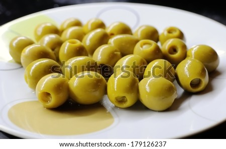 Anchovy stuffed olives in a plate