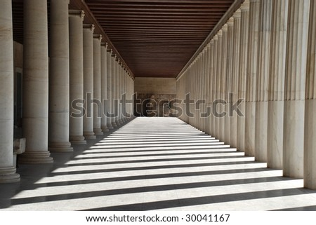 Ancient Agora. Ancient greek stoa. Column arcade.