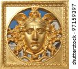 Ancient baroque golden mask on Palazzo Reale (The Royal Palace) fence in Turin Italy - stock photo