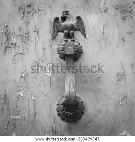 Ancient door handle with an eagle figure