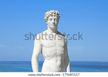 Ancient greek statue of a young athlete by the sea