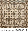 Ancient Moorish floral pattern on a grungy clay floor tile for textural background. - stock photo