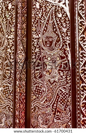 ancient painting art on thai temple door