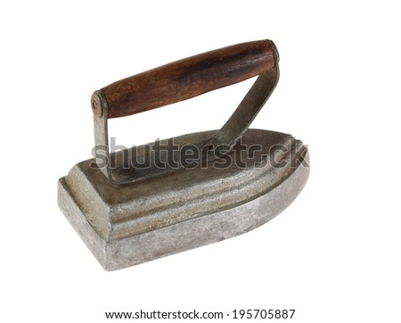 Ancient pig-iron iron with the wooden handle. Isolated