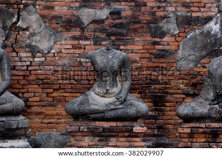 Ancient Ruin Stone Buddha Statue in Ayutthaya Province, Thailand