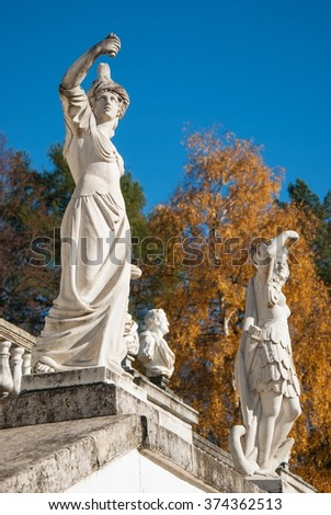 Ancient sculpture on the terrace in the autumn park
