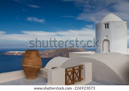 Ancient vase and windmill at Santorini, Greece