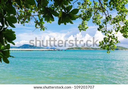 Andaman sea islands and moorage through leaves of tropical trees