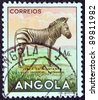 "ANGOLA - CIRCA 1953: A stamp printed in Angola from the ""Angolan fauna"" issue shows a zebra, circa 1953. - stock photo"